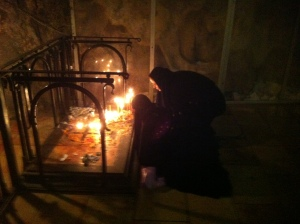 Deep inside the Church of the Holy Sepulcher, orthodox nuns light candles.