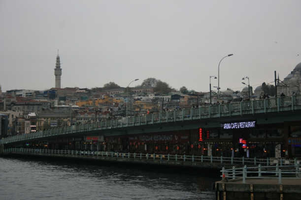 The fishing is above the bridge. The fish restaurants are below.