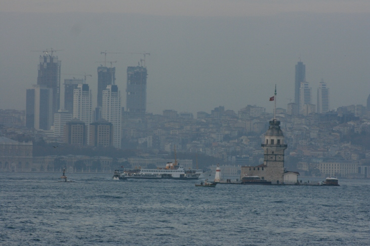 This is Istanbul. The famous maiden's tower in the foreground and skyscraper construction in the background.